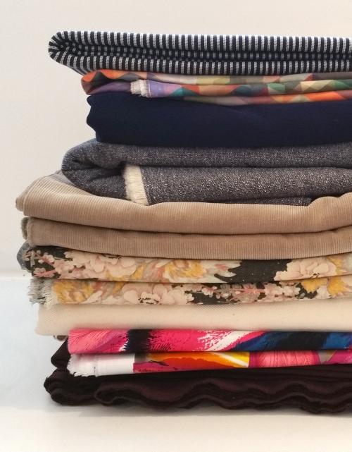 pile of folded fabrics